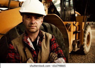 quarry worker and his excavator