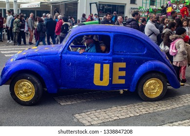 Quarteira, Portugal, 5th March 2019.  An old Volkswagen beetle car decorated to participate in Carnaval Quarteira.