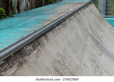 A quarter pipe for skating or bmx made of cement.