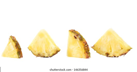 Quarters of slices pineapple.