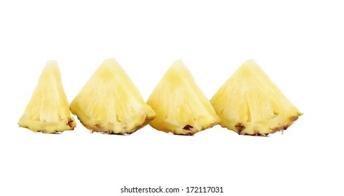 Quarters of slices pineapple in a row. Isolated on a white background.