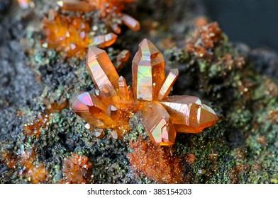 Quartz crystals coated with iridescent limonite from Banska Stiavnica, Slovakia.
