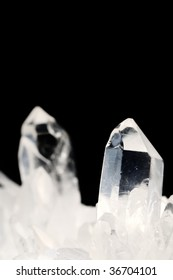Quartz crystals on black background with copy space
