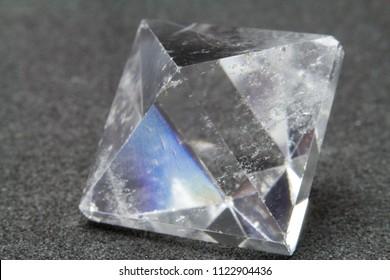 Quartz octahedron in black background
