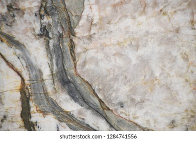 Quartzite stone with natural pattern texture background.