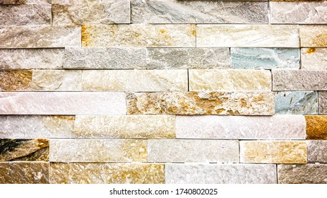 Quartzite tile wall with tan and grey earth tones and blue stones