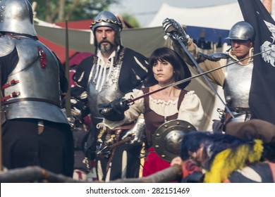"""QUATTRO CASTELLA, ITALY - MAY 17, 2015: warriors in medieval staged battle at festival """"RIEVOCANDUM1111"""" A.D. 1557 devoted to the life in middle ages, on May 17, 2015 in Quattro Castella, Italy"""