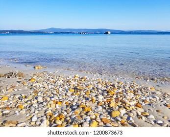Quatz boulders on the shore of the beach in Arousa Island