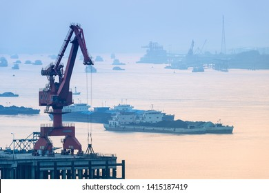 quay crane closeup, inland river wharf scene, the yangtze river freight transportation in early morning