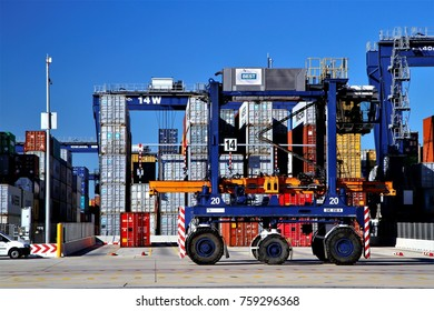 Quay straddle carrier driver and Semi-auto container terminal yard operation in Port of Barcelona, Spain, June 3, 2015.