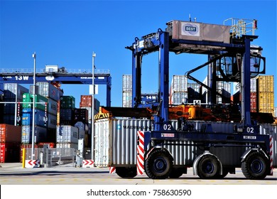Quay straddle carrier and Semi-auto container terminal yard operation in Port of Barcelona, Spain, June 3, 2015.