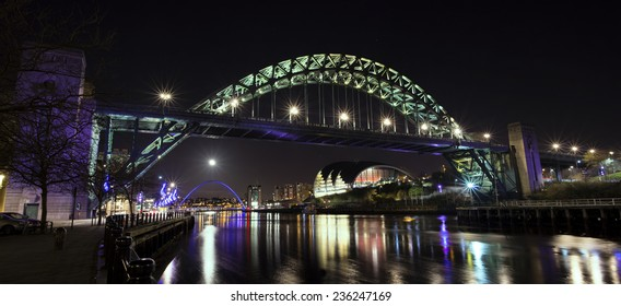 The Quayside at Newcastle upon Tyne and Gateshead, England. The River Tyne, the Tyne Bridge, the Millenium Bridge, the Baltic Centre for Contemporary Art and the Sage Gateshead are all visible.