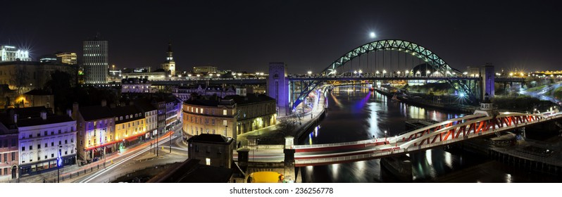 The Quayside at Newcastle upon Tyne and Gateshead photographed at night.