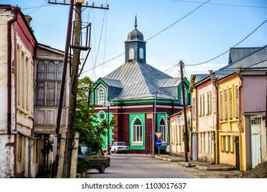 Quba, Azerbaijan - view of the Ardabil Mosque located on the main street of the town with an old car parking