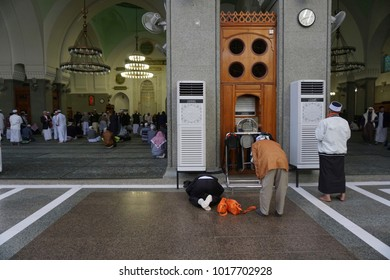 Quba Mosque, Madinah-February 4th, 2018: Muslim worshipers performing solat inside the Quba Mosque. Quba Mosque is the first mosque build by Prophet Muhammad SAW