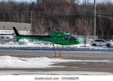 Quebec, Quebec, Canada - 02-13-2021:  Heli Explress AS350 parked and grounded, used for parts.