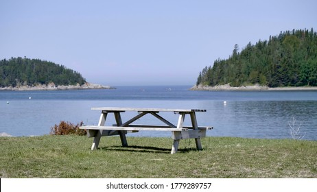 Quebec, Quebec, Canada 07/19/2020: Lonely park Picnic table overlooking the ocean in Quebec, Canada parc du Bic.