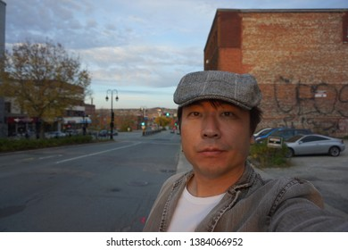 quebec, canada, 10 22 2017 : a man standing at rue king ouest of sherbrooke town on the townships trail of eastern townships in quebec