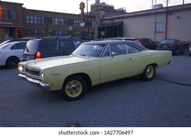 quebec, canada, 10 22 2017 : view of classic car named plymouth satellite parked at rue camirand of sherbrooke town on the townships trail of eastern townships in quebec