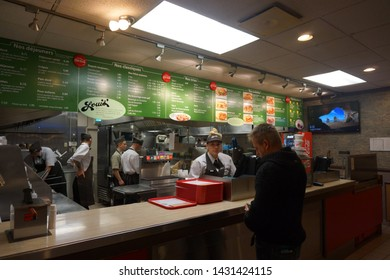 quebec, canada, 10 22 2017 : view of fast food restaurant named louis at rue king ouest of sherbrooke town on the townships trail of eastern townships in quebec