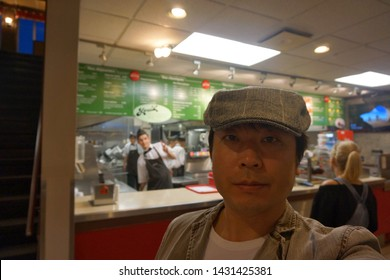 quebec, canada, 10 22 2017 : a man standing at fast food restaurant named louis at rue king ouest of sherbrooke town on the townships trail of eastern townships in quebec