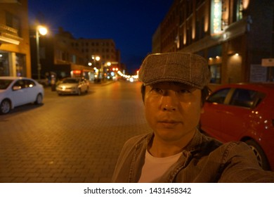 quebec, canada, 10 22 2017 : a man standing at rue wellington south of sherbrooke town on the townships trail of eastern townships in quebec