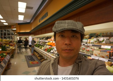 quebec, canada, 10 22 2017 : a man standing at provigo grocery store at rue queen of sherbrooke town on the townships trail of eastern townships in quebec