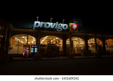 quebec, canada, 10 22 2017 : night view of provigo grocery store at rue queen of sherbrooke town on the townships trail of eastern townships in quebec