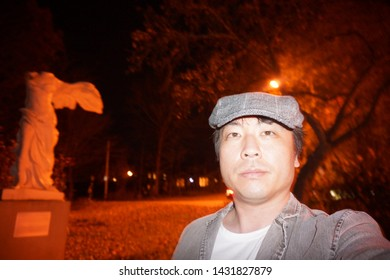 quebec, canada, 10 22 2017 : a man standing in front of sculpture of angel without head at rue uplands of sherbrooke town on the townships trail of eastern townships in quebec