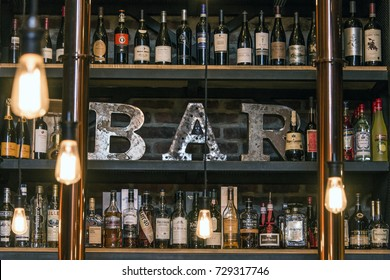 Quebec Canada 13.09.2017 - Bitters and liquor bar counter with bottles toned vintage style brick wall and ambient light