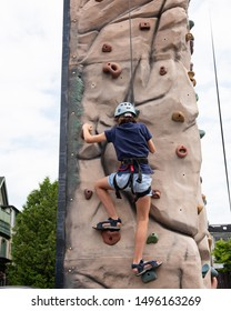 Quebec, Canada. August 3, 2019.  Young boy practicing rappelling.