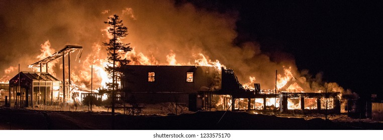 Quebec, Canada - December 2016 - Huge fire blazing in commercial building.