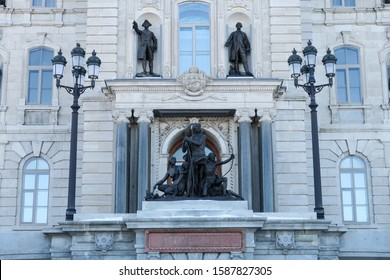 Quebec, Canada - december 2019 : Front view of Quebec's Parliament building, with a sculpture of a First nations family, a statue of General Wolfe and a statue of Lieutenant General Montcalm