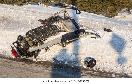 Quebec, Canada - January 2018 - snowmobile accident, skidoo overturn.