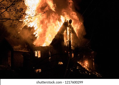 Quebec, Canada - October 2018 - House fire with intense flame.