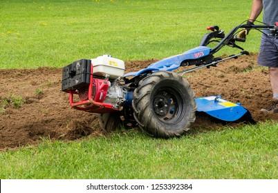 Quebec, Canada-25 may 2018 : BCS 853 13 HP rototiller  is a popular tractor unit preparing soil on outdoor garden