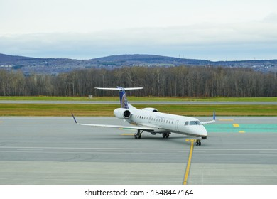 QUEBEC CITY, CANADA -2 NOV 2019- View of an Embraer regional jet from United Express (UA) the Jean Lesage International Airport (YQB) in Quebec City, Canada.