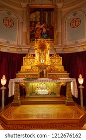 QUEBEC CITY, CANADA - AUG 22, 2012: Main altar at the historic Jesuit Chapel or Chapelle des Jesuites in Old Quebec city. Made of gilded pine, it was designed by Canadian Eugene Tache in 1888.