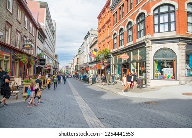 Quebec City, Canada - August 5, 2015:people and tourists stroll through the quaint streets of Quebec City during a summer morning. Here we are on Rue Saint Jean