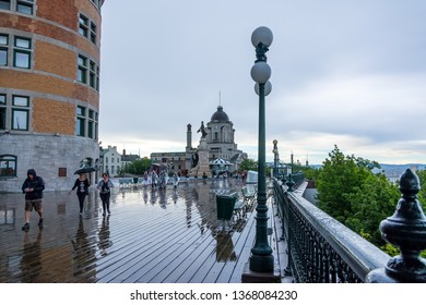 Quebec City, Canada - August 5, 2015strolling  on the Dufferin terrace in  Quebec City near the Frontenac castle during a cloudy morning.