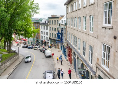 Quebec City, Canada - August 6, 2015: strolling in a characteristic street of Quebec city during a cloudy morning.