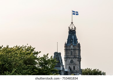 QUEBEC CITY CANADA The blue and white flag flies proudly on top of the impressive clock tower of the parliament building of the national assembly