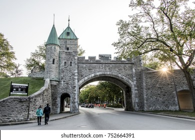 Quebec City Canada historic fortified wall with street at sunset with couple going for a stroll