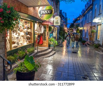 QUEBEC CITY, CANADA - JULY 20, 2008: Tourists enjoy city streets. Quebec welcomes more than 4 million tourists each year.