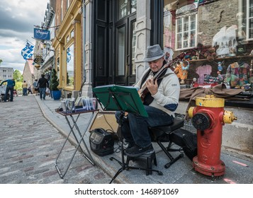 QUEBEC CITY, QUEBEC, CANADA - JULY 21: Street artist of Quebec City performing, in Quebec City, Quebec, Canada, on July 21, 2013. Quebec is a French speaking province, with European style performers.