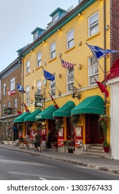 Quebec City, Canada - June 27, 2018: Colorful Houses  and restaurants on Rue Saint Louis (St. Louis Street) in Quebec City, Quebec, Canada. Old Quebec City is UNESCO World Heritage Site since 1985.