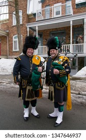 Quebec City, Quebec, Canada, March 23, 2019- Two smiling members of the NYPD Emerald Society posing before the St. Patrick parade in downtown Quebec City