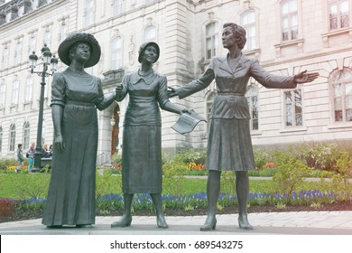 QUEBEC CITY, QUEBEC, CANADA - MAY 25, 2017: Statues of Therese Casgrain, Idola St. Jean and Marie Lacoste Gérin-Lajoie, suffragettes on the grounds of the Quebec legislature in Quebec City, Canada.