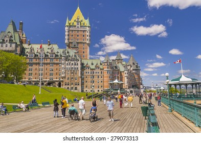 QUEBEC CITY, QUEBEC, CANADA -  MAY 30, 2004: Le Chateau Frontenac castle and hotel, with people walking along Dufferin Terrace boardwalk, a National Historic Site, in Old Quebec City.