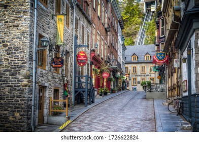 QUEBEC CITY, CANADA - OCTOBER 03, 2019: Rue Sous le Fort and Quebec funicular in the background.